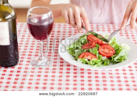 Charming Woman eating lunch and drinking wine in a kitchen poster