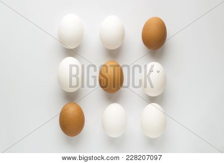 Set Of Fresh Chicken Egg In Container On White Paper Background. Concept For Easter With Copy Space.