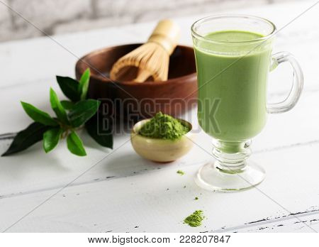 Matcha Green Tea Latte Beverage In Glass Cup On White Background