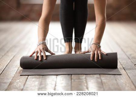 Young Woman Rolling Black Fitness Or Yoga Mat Before Or After Sport Practice, Working Out At Home In