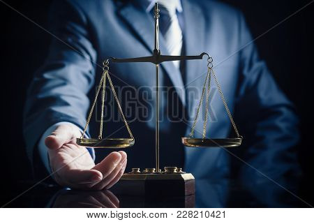 Weight Scale Of Justice, Lawyer In Background. Justice Law Lawyer Attorney Scale Weight Court Author