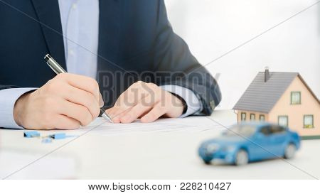 Insurance Agent In Office. Home And Car Safety Care Concept