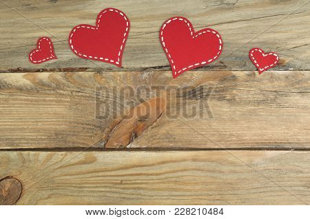 Red Paper Hearts On A Wooden Background. Valentine's Day. Copy Space. Top View.