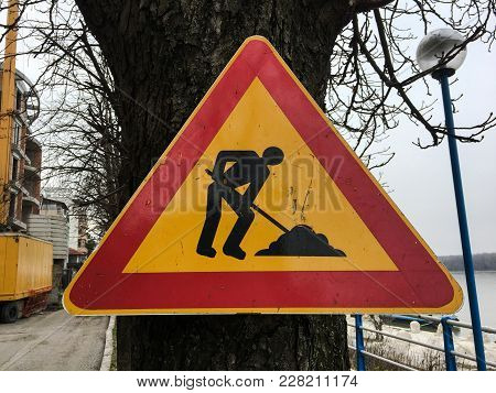 Road Repair Sign. Street Road Under Construction. Road Signs On The Roadside Along The Road Warning