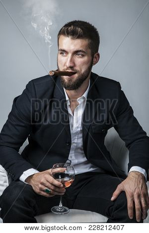 Attractive Businessman With A Cigar And A Drink