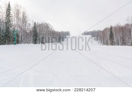 The Ski Slope. Ski Slope In The Forest. Beautiful Winter Forest In The Taiga. Trees Under The Snow.