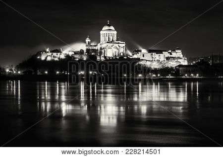 Esztergom Basilica With Reflection In Danube River, Hungary. Night Scene. Cultural Heritage. Place O