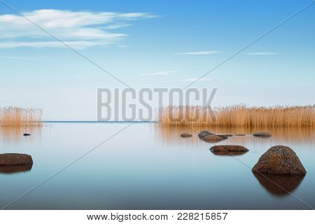 Horizontal Shot Of The Blue Sky Is Reflecting Ladoga Lake In The Evening