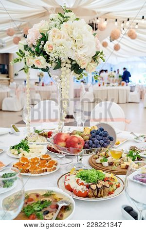 Table Setting At Luxury Wedding Reception. Beautiful Flowers On Wedding Table. Number At Table For G