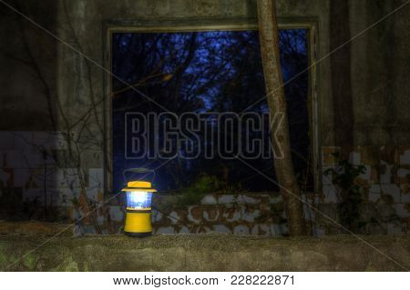Luminous Hand Lantern Standing On The Dilapidated Wall Of The Abandoned Restaurant On The Top Of Mou