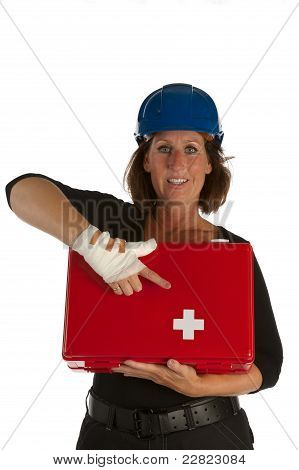 Wounded Female Shows The First Aid Kit With Her Injured Hand