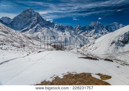 Beautiful View Of Ama Dablam And Kanthega Peaks, With Periche Village In The Distance