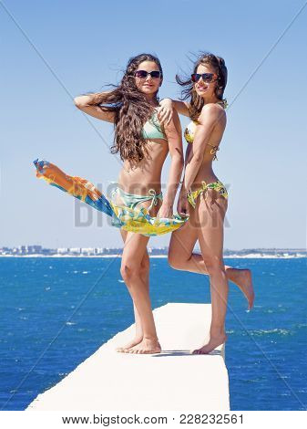 Summer Vacation, Vacation, Travel And Tourism People Concept - Smiling Young Woman With Sunbathing O