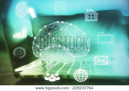 Toned Image Of Laptop With Polygonal Brain Hologram. Artificial Intelligence Concept. Double Exposur
