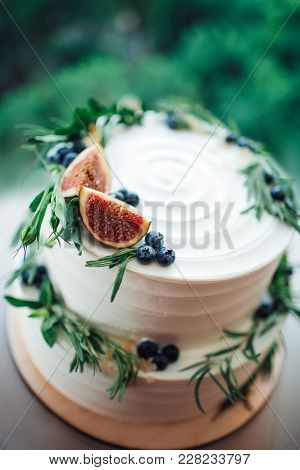 Rustic Wedding Cake Decorated With Figs And Greenery Rosemary.