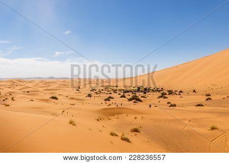 The Seas Of Dunes Of Erg Chebbi Near Merzouga In Southeastern Morocco.
