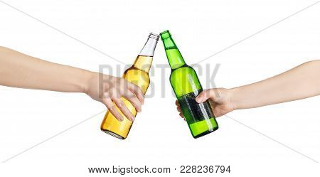 Female Hands With Cold Beer Bottles, Isolated On White Background. Beer Up. Cheers. Pair Of Beer Bot
