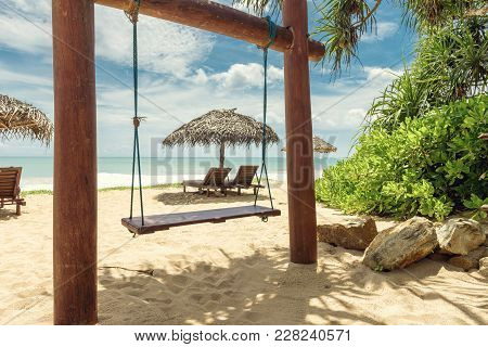 Scenic View Of A Sand Beach In Tropic, Sri Lanka. Beach Beds With Umbrellas On The Tropical Beach. B