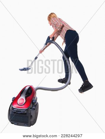 Rear view of a woman with a vacuum cleaner. She is busy cleaning. Rear view people collection.    Isolated over white background. blonde in a black pants with red vacuum cleaner.