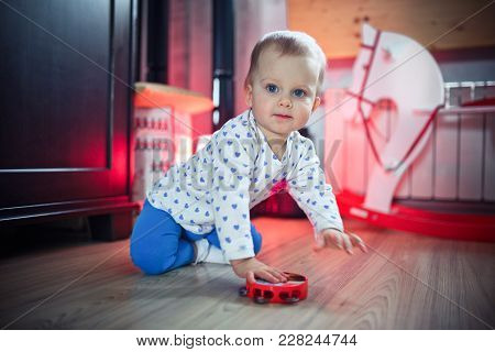 A Little Girl, 1 Year Old, Play With Toys On The Floor