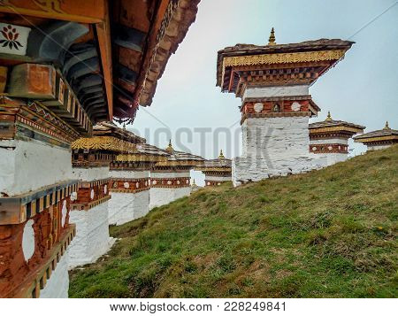 The 108 Chortens Or Stupas Is A Memorial In Honour Of The Bhutanese Soldiers With Layer Of Mountains