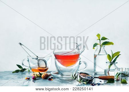 Sprink Drink Photography Concept. Glass Transparent Teacups In A High-key Spring Still Life With Gla