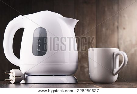 White Plastic Electric Kettle On The Table