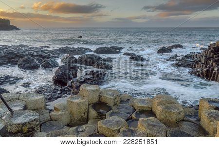 Giant's Causeway, North Ireland, Uk During Winters. The Fierce Waves Batter The Iconic Coastline Of