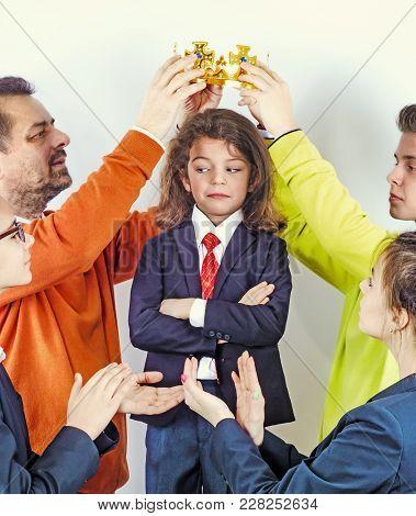 The Hands Of Grown Men Wear A Golden Crown On A Guy's Head In A Business Suit. Winner. Leader. A Sel