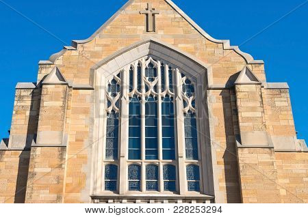 Architectural Detail Of Church Stone Facade Upper Story And Windows