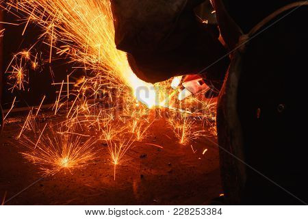 Sparks And Smoke From Welder Arc Gouging Carbon Electrode Rods