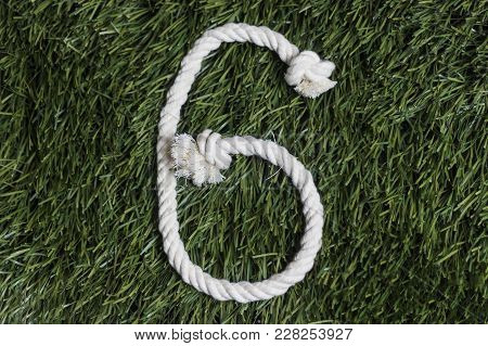 Rope Numbers On Grass Background. Number 6. Six