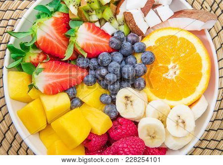 A  Bowl Of Fruit Salad With Mixed Fresh Fruit