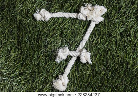 Rope Numbers On Grass Background. Number 7. Seven