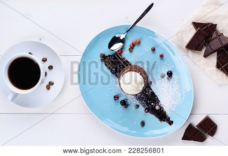 Tasty Chocolate Lava Cake With Vanilla Ice Cream Ball And Berries On Plate On White Table. Chocolate