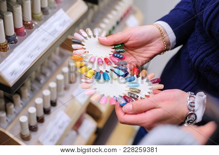 Young Female Choosing A Nail Lacquer Color In The Shop