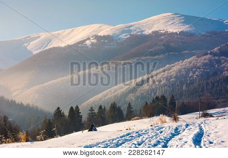Wonderful Winter Landscape In Mountains. Beautiful Countryside With Snow Covered Mountains In The Di