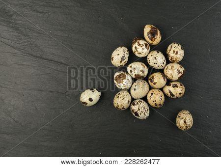 Quail Eggs On Stone Background
