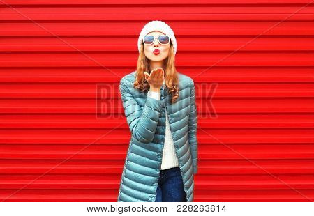 Fashion Woman Is Blowing Red Lips Sends An Air Kiss On Background