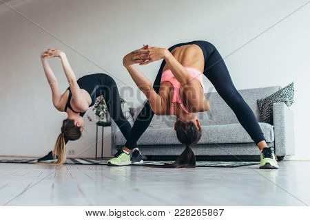Fitness Women Back Stretching Training At Home. Young Slim Girl Makes Forward Bend.