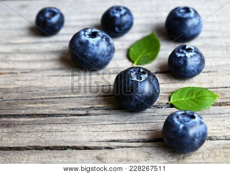 Fresh Ripe Blueberries With Green Leaves On Rustic Wooden Table.bilberry Border.flat Lay,top View,se