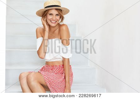 Portrait Of Adorable Young Female With Slim Perfect Body Shape, Wears Straw Hat, Demosntrates Bare S