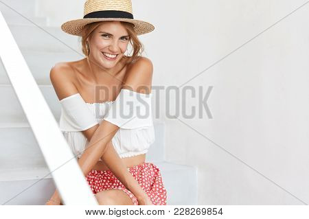 Beautiful Woman In Stylish Hat, White Fashionable Blouse, Looks With Positive Expression, Being Glad