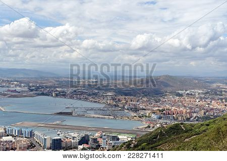 An Aerial View Of Gibraltar, The Gibraltar Bay And The Spanish Shore With The Town Of La Linea As Se