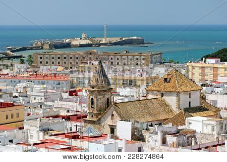 Aerial View Of Cadiz From Torre Tavira With San Sebastian Castle In Andalucia, Spain, An Ancient Por