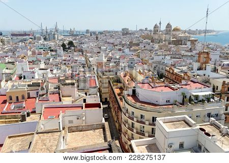 Aerial Panoramic View Of The Old City Rooftops And Cathedral De Santa Cruz From Tower Tavira In Cadi