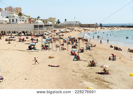 Cadiz, Spain - August 31, 2017: People Relaxing On Caleta Beach In Cadiz, Spain, An Ancient Port Cit
