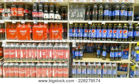 Piatra Neamt, Romania - February 16: Coca Cola And Pepsi Soda Drinks For Sale On Stand, In A Shop On