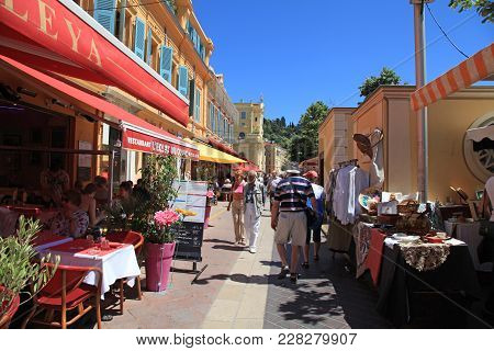 Nice, France - May 13, 2013: Tourists And Locals Enjoy Cafe And Antique Market At The Cours Saleya,