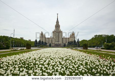 Moscow, Russia - May 31, 2017: Main Building Of Moscow State University At The Background And Flower